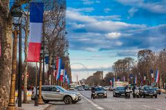 Champs Elysees and the Wheel of Paris in a cold winter day in Paris. PARIS, FRANCE - MARCH, 2018: Champs Elysees and the Wheel of Paris in a cold winter day in stock images