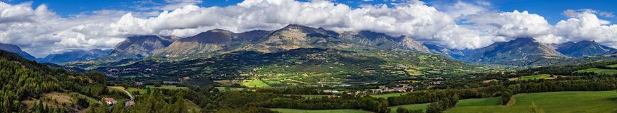 Champsaur and the Drac Valley in summer. Hautes-Alpes, Alps, France. Panoramic summer afternoon view on the Champsaur and the Drac Valley. From left to right the stock image