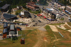 Chamrousse from the cable car. Chamrousse village seen from the cable car down from summit Royalty Free Stock Images