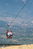 Chamrousse cable car over the city of Grenoble. CHAMROUSSE, FRANCE, JULY 17, 2014 : Chamrousse cable car over the city of Grenoble.  Chamrousse is a well-known Royalty Free Stock Photo