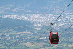 Chamrousse cable car over Grenoble city. CHAMROUSSE, FRANCE, JULY 17, 2014 : Chamrousse cable car ver the city of Grenoble.  Chamrousse is a well-known ski Stock Photography