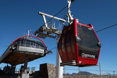 Chamrousse cable car summit station. CHAMROUSSE, FRANCE, August 26, 2015 : A cable car with small cabins joins the ski resort of Chamrousse -  Le Recoin at the Stock Images