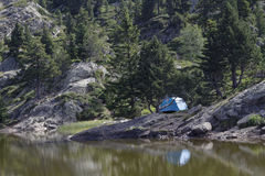 Camping on the banks of the Mountain Lake Stock Photography