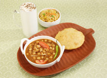 Chana Masala or Spicy Chick Peas with Bhature and Buttermilk Stock Photo