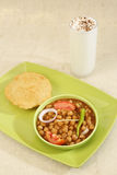 Chana Masala or Spicy Chick Peas with Bhature and Buttermilk, In Royalty Free Stock Photography