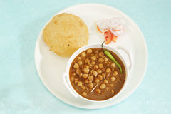Chana Masala or Spicy Chick Peas with Bhature - Indian Food Royalty Free Stock Photos