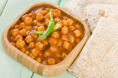 Chana Masala. Spicy chickpea curry served with chapatis Stock Images