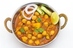 Chana Masala - um prato de vegetariano picante indiano para o almoço e o ruído Imagem de Stock Royalty Free