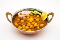 Chana Masala - um prato de vegetariano picante indiano para o almoço e o ruído Imagens de Stock Royalty Free