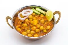 Chana Masala - um prato de vegetariano picante indiano para o almoço e o ruído Imagens de Stock