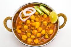Chana Masala - un piatto vegetariano piccante indiano per pranzo e baccano immagini stock libere da diritti