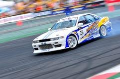 Chanapol die zijn auto afdrijft bij de Afwijking 2010 van de Formule Stock Foto