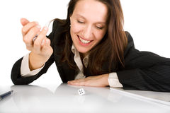 Chance is back. Businesswoman throwing dices on white office table Royalty Free Stock Photography