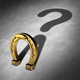 Chance Question. And luck questions as a horseshoe icon or horse shoe odds symbol as a golden metal lucky charm object as a metaphor for fortune and lotto or royalty free illustration