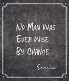 By chance Seneca quote. No man was ever wise by chance - ancient Roman philosopher Seneca quote written on framed chalkboard stock images