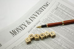 Chance stocks. Stock page with Chance dice on newspapers Stock Images