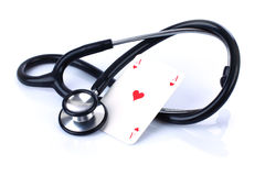 Chances of health. Stethoscope and card / Don't gamble with your health Royalty Free Stock Images