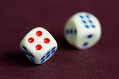 Chances Unclear. A concept suggesting a lack of clarity when taking chances. A pair of dice in motion and a shallow Depth-of-Field is used to portray an unclear Royalty Free Stock Photo