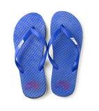 Chancletas azules de Nike aisladas en un fondo blanco Fotos de archivo