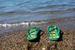 Chancletas en la playa Imagen de archivo libre de regalías