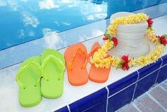 Chancletas y accesorios de la piscina Fotografía de archivo libre de regalías