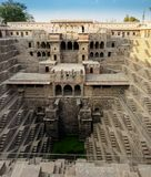 Chand Baori Step well in the village of Abhaneri, Rajasthan State, India, in vertical panoramic view.