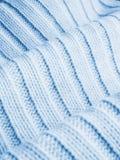Chandail de laine bleu ; fond Photographie stock libre de droits