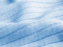 Chandail de laine chaud bleu ; fond Images libres de droits