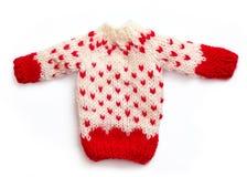 Chandail tricoté de Noël dans la couleur blanche et rouge, d'isolement sur le blanc Photo stock