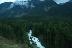 Chandanwari landscape in Pahalgam-7. A superb landscape with a dark mountains with a waterfall in Kashmir Stock Photos