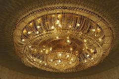 Chandelier. Crystal chandelier with yellow light Stock Photo