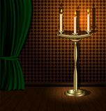 Chandelier. A darkened room with a green awning on the wooden floor is a large chandelier a with three candles Royalty Free Stock Photos