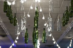 Chandelier. Made of wine bottles hanging on ceiling royalty free stock photos
