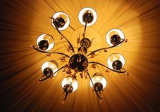Chandelier. Luxury chandelier from glass with stylish lamps Royalty Free Stock Photo