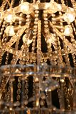 Chandelier. A lit crystal chandelier hanging royalty free stock photos