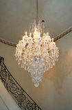 Chandelier. A beautiful crystal chandelier hangs in the entryway of a home Stock Image
