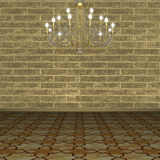 Chandelier against the background of a brick wall. Royalty Free Stock Photography