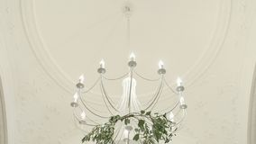 Chandelier in the apartment. A beautiful chandelier on the ceiling of the apartment stock footage