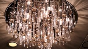 Chandelier in the apartment. Scene. A beautiful chandelier on the ceiling of the apartment. elegant chandelier on the royalty free stock photo