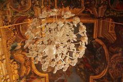 Beautiful chandelier on the ceiling royalty free stock image