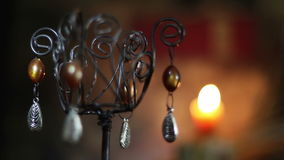 Chandelier and a burning candle stock footage