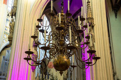 Chandelier with candles in the cathedral of Den Bosch Royalty Free Stock Image
