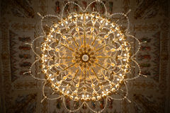 Chandelier in the Catherine Palace at Tsarkoe Selo in St. Petersburg, Russia. A crystal and golden chandelier hangs over the opulent, elegant ballroom the Royalty Free Stock Photography