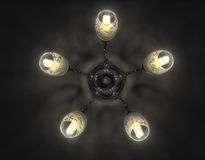 The chandelier on the ceiling. The electric chandelier hanging on the ceiling Royalty Free Stock Images