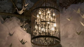 Chandelier in cell as element of interior stock video
