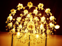 Chandelier. S are often ornate, and normally use incandescent light bulbs, though some modern designs also use fluorescent lamps and recently LEDs Stock Photo