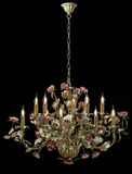 Chandelier classic bronze with curly lampshades flowers and gold leaves. Stock Photography