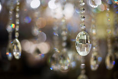Chandelier close-up. Close-up of a cut glass chandelier and the resultant abstract light reflections and refractions Royalty Free Stock Photos