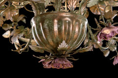 Chandelier close-up classic bronze with curly lampshades flowers and gold leaves. Royalty Free Stock Photography