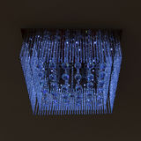 Chandelier crystal blue light on black wall Royalty Free Stock Images
